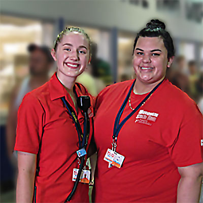 Jackie, a teen, with her supervisor working at the Wisconsin State Fair.