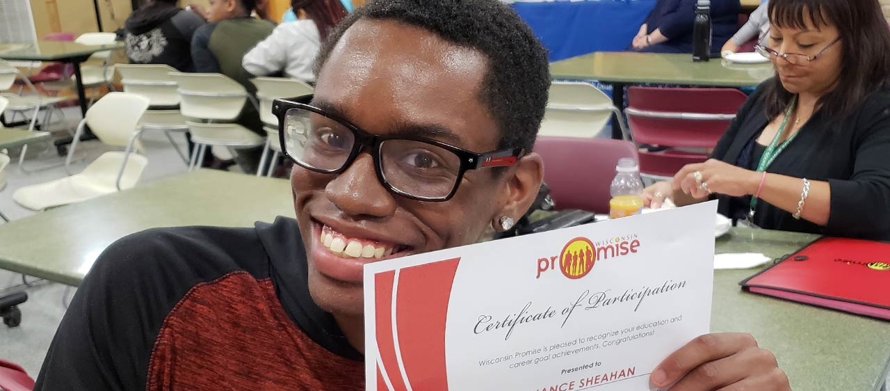 Promise participant proudly holds diploma of participation-we're proud